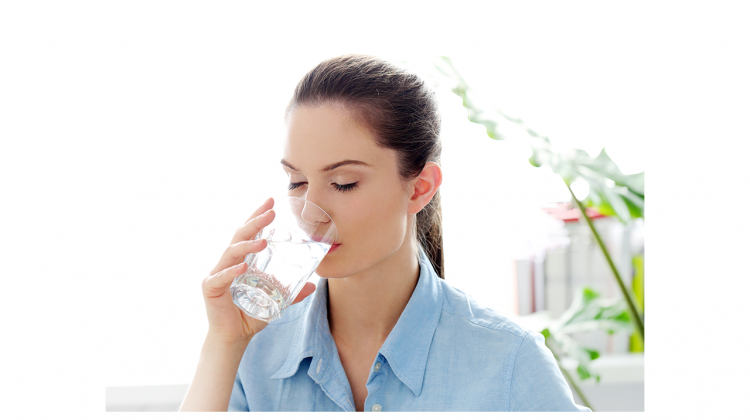 Lady Drinking Water taking Ayurveda in practice
